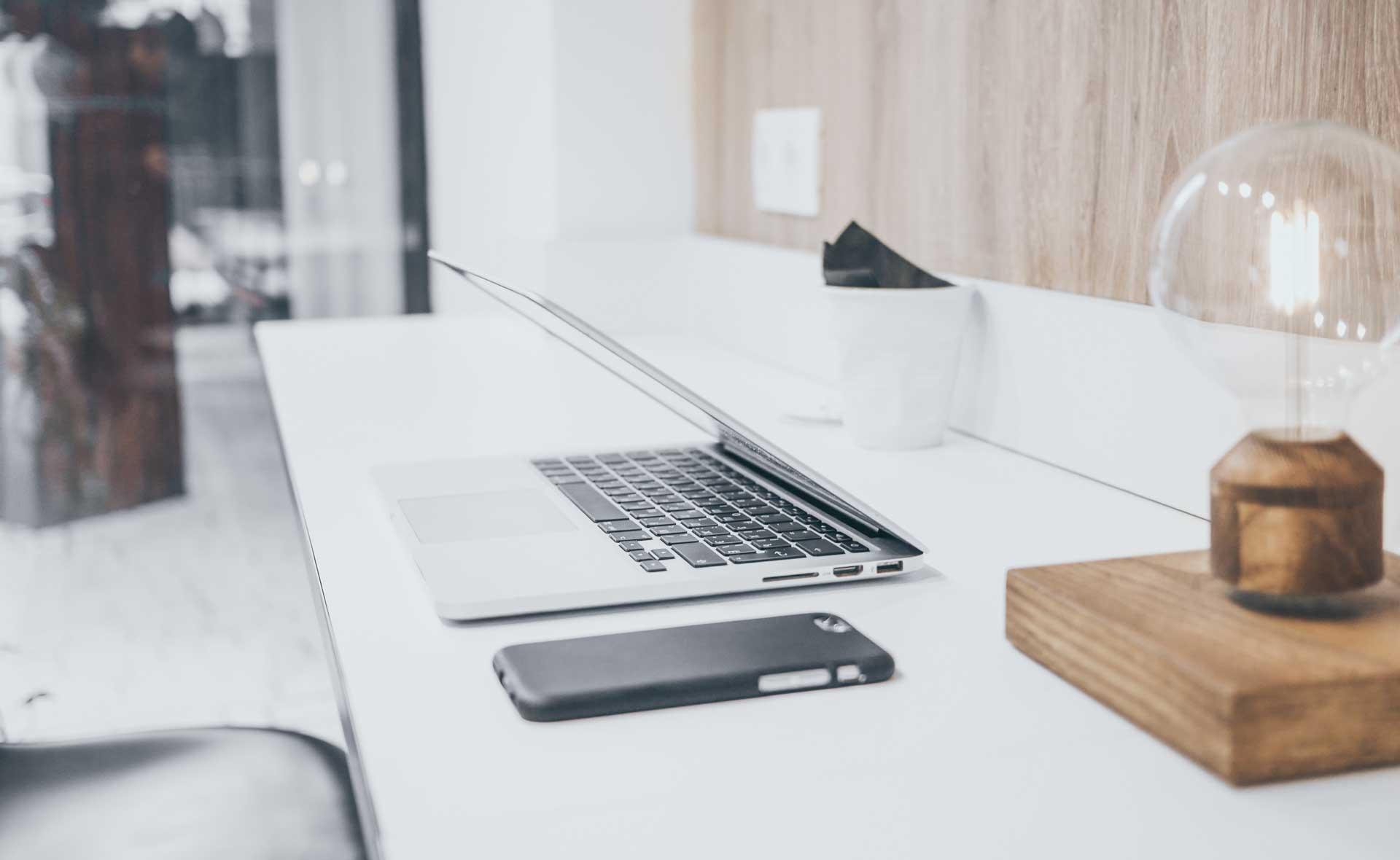 laptop on desk - Caroline Allen