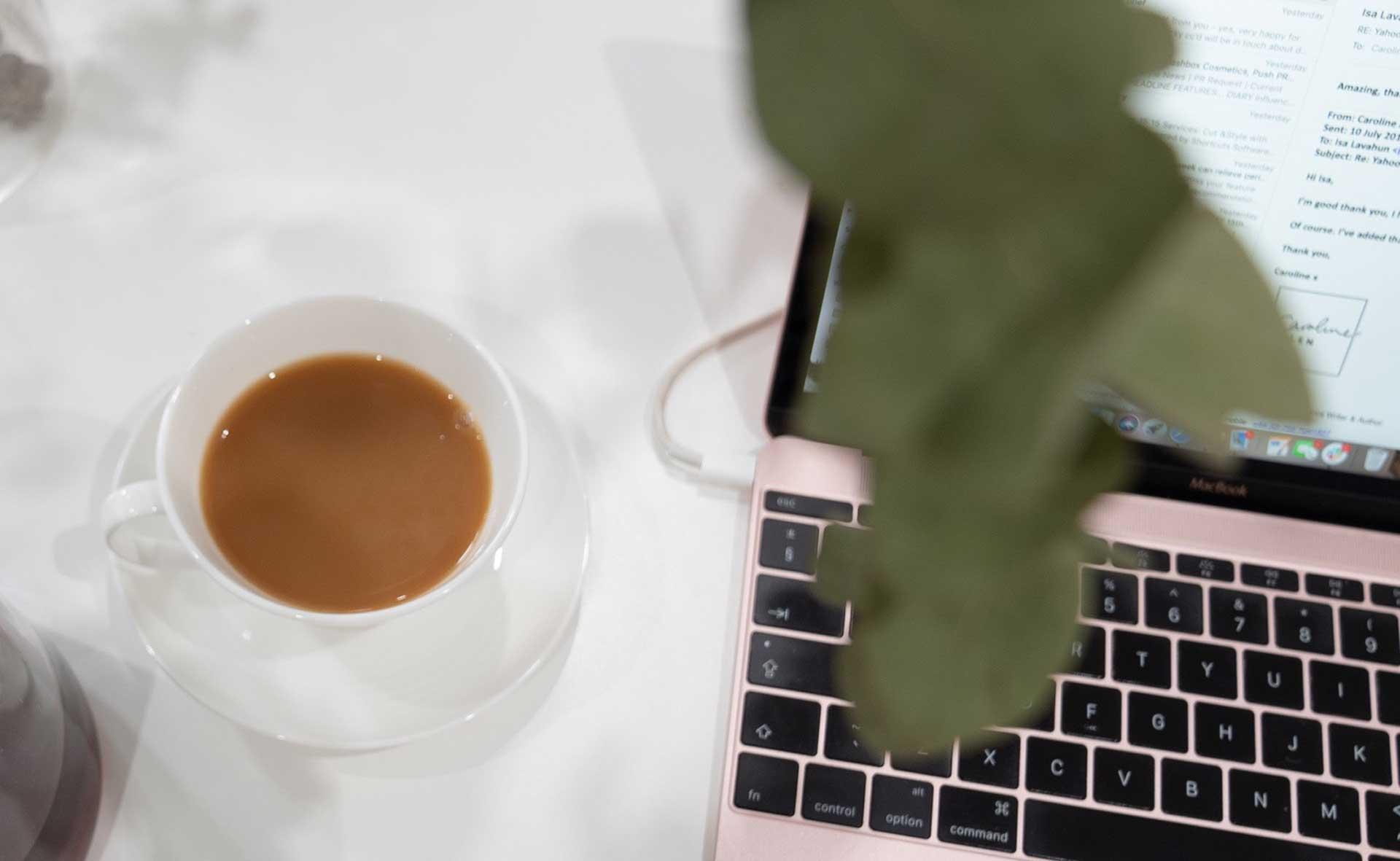 tea cup and laptop - Caroline Allen